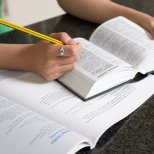 Student with dictionary and textbook