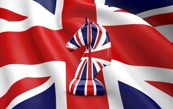 Horse Chess in UK Flag Pattern with UK Flag Background. High Resolution Flag of Britain silk. 3D Render.